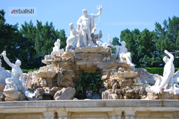 Peeking through the fountain in the immense gardens of Schonbrunn Castle in Vienna, Verbalisti
