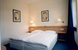 Accommodation in 2 bed rooms with own WC-shower, on the floors above the classrooms